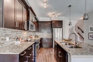 Photo 10: 215 Sunset Point: Cochrane Row/Townhouse for sale : MLS®# A1148057