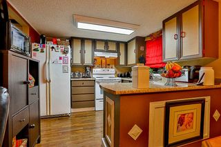 Photo 8: 205 7165 133 Street in Surrey: West Newton Townhouse for sale : MLS®# R2123385