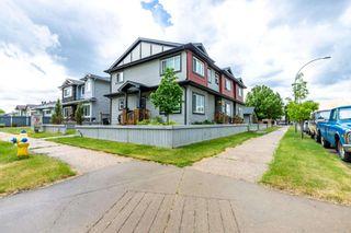 Photo 2: 4002 117 Avenue in Edmonton: Zone 23 House Triplex for sale : MLS®# E4249819