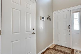Photo 3: 308 PROMINENCE Heights SW in Calgary: Patterson Semi Detached for sale : MLS®# A1037279