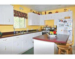 Photo 7: 1402 COMO LAKE AV in Coquitlam: Central Coquitlam House for sale : MLS®# V536066
