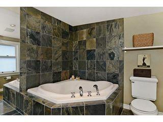 """Photo 13: 436 E 35TH AV in Vancouver: Fraser VE House for sale in """"MAIN ST CORRIDOR"""" (Vancouver East)  : MLS®# V1044645"""