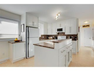 Photo 8: 803 104 Avenue SW in Calgary: Southwood House for sale : MLS®# C4092868