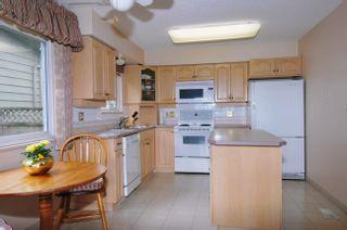 "Photo 10: 20875 125TH Avenue in Maple Ridge: Northwest Maple Ridge House for sale in ""CHILCOTIN"" : MLS®# V890482"