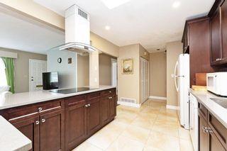 Photo 9: 709 QUADLING Avenue in Coquitlam: Coquitlam West House for sale : MLS®# R2577078