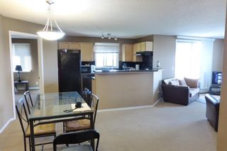 Photo 5: 2101 8 BRIDLECREST Drive SW in Calgary: Bridlewood Condo for sale : MLS®# C4113110