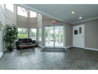 "Photo 3: 103 3063 IMMEL Street in Abbotsford: Central Abbotsford Condo for sale in ""Clayburn Ridge"" : MLS®# R2080632"