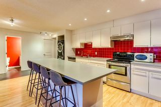 Photo 2: 101 1059 5 Avenue NW in Calgary: Sunnyside Apartment for sale : MLS®# A1115946