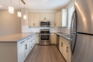 Photo 12: 48 Carringvue Link NW in Calgary: Carrington Semi Detached for sale : MLS®# A1111078