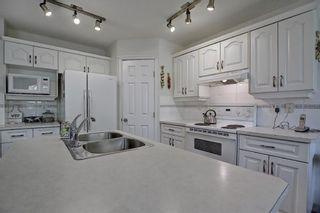 Photo 6: 414 Douglas Woods Mews SE in Calgary: Douglasdale/Glen Detached for sale : MLS®# A1114756