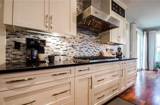 Photo 7: 202 FORTRESS Bay SW in Calgary: Springbank Hill House for sale : MLS®# C4098757