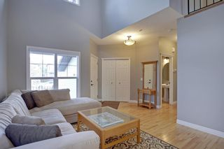 Photo 4: 145 TREMBLANT Place SW in Calgary: Springbank Hill Detached for sale : MLS®# A1024099