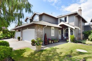 """Photo 1: 6139 W BOUNDARY Drive in Surrey: Panorama Ridge Townhouse for sale in """"LAKEWOOD GARDENS"""" : MLS®# F1448168"""