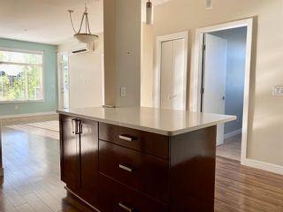 Photo 3: 209 10 Auburn Bay Link SE in Calgary: Auburn Bay Apartment for sale : MLS®# A1147935