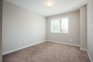 Photo 13: 8 Everridge Gardens SW in Calgary: Evergreen Row/Townhouse for sale : MLS®# A1041120