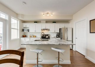 Photo 2: 23 43 Springborough Boulevard SW in Calgary: Springbank Hill Row/Townhouse for sale : MLS®# A1096948