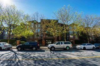 "Photo 1: 412 700 KLAHANIE Drive in Port Moody: Port Moody Centre Condo for sale in ""BOARDWALK"" : MLS®# R2573669"