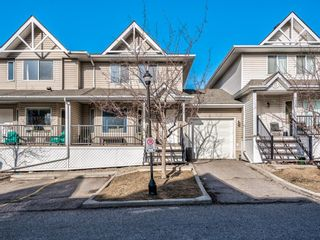 Photo 1: 410 950 Arbour Lake Road NW in Calgary: Arbour Lake Row/Townhouse for sale : MLS®# A1087504