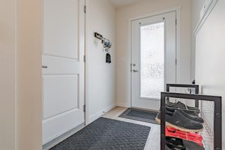 Photo 3: 145 Shawnee Common SW in Calgary: Shawnee Slopes Row/Townhouse for sale : MLS®# A1097036