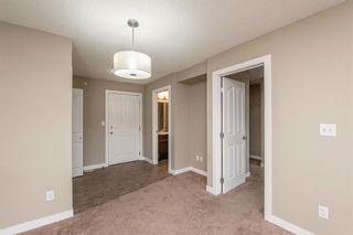 Photo 13: 413 7130 80 Avenue NE in Calgary: Saddle Ridge Apartment for sale : MLS®# A1144458