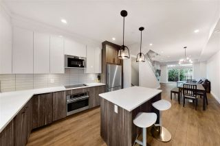 """Main Photo: 2410 DUNDAS Street in Vancouver: Hastings Sunrise Townhouse for sale in """"NANAIMO WEST"""" (Vancouver East)  : MLS®# R2545751"""