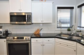 Photo 5: 7476 Springbank Way SW in Calgary: Springbank Hill Detached for sale : MLS®# A1071854