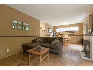 """Photo 4: 3345 MOUNTAIN Highway in North Vancouver: Lynn Valley Townhouse for sale in """"VILLAGE ON THE CREEK"""" : MLS®# V1141033"""
