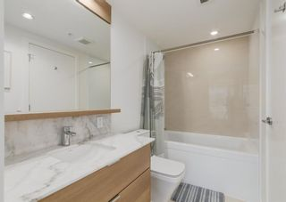 Photo 18: 406 108 Waterfront Court SW in Calgary: Chinatown Apartment for sale : MLS®# A1108137