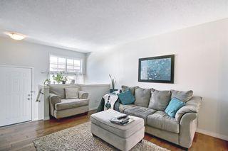 Photo 8: 3028 New Brighton Gardens SE in Calgary: New Brighton Row/Townhouse for sale : MLS®# A1125988