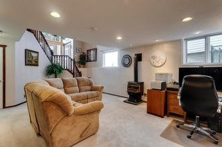 Photo 25: 388 Sienna Park Drive SW in Calgary: Signal Hill Detached for sale : MLS®# A1097255