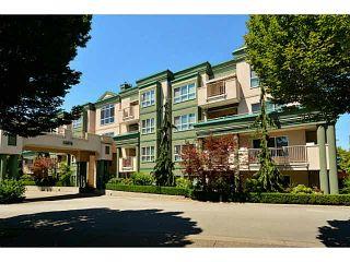 "Photo 1: 204 13870 70 Avenue in Surrey: East Newton Condo for sale in ""Chelsea Gardens - Mayfair"" : MLS®# F1445992"