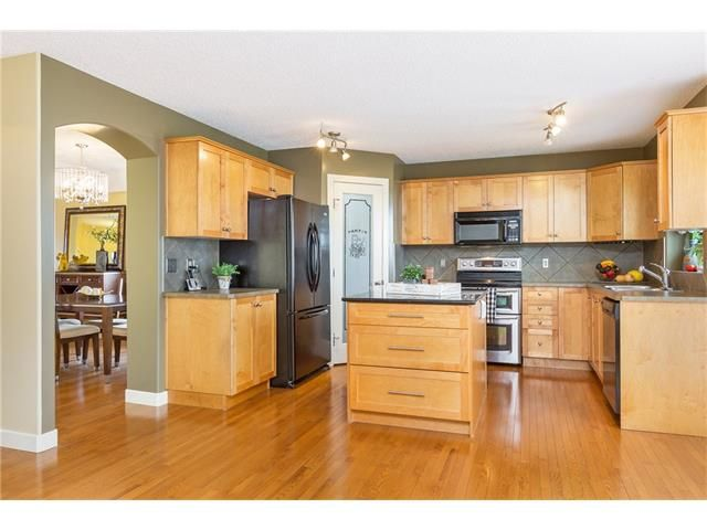 Photo 11: Photos: 664 LUXSTONE Landing SW: Airdrie House for sale : MLS®# C4106944