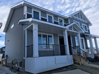 Photo 1: 11 Sundown Manor: Cochrane Semi Detached for sale : MLS®# A1071566