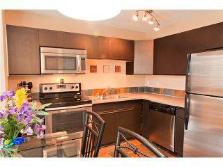 Photo 7: 94 123 QUEENSLAND Drive SE in Calgary: Queensland House for sale : MLS®# C4027673