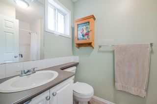 Photo 21: 143 Stonemere Place: Chestermere Row/Townhouse for sale : MLS®# A1132004