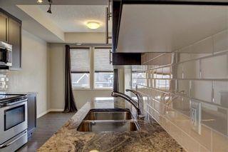 Photo 13: 124 AUBURN MEADOWS Walk SE in Calgary: Auburn Bay Row/Townhouse for sale : MLS®# C4273742