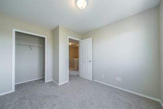 Photo 25: 404 720 Willowbrook Road NW: Airdrie Row/Townhouse for sale : MLS®# A1098346
