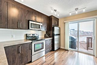 Photo 7: 1562 93 Street SW in Calgary: Aspen Woods Row/Townhouse for sale : MLS®# A1085332