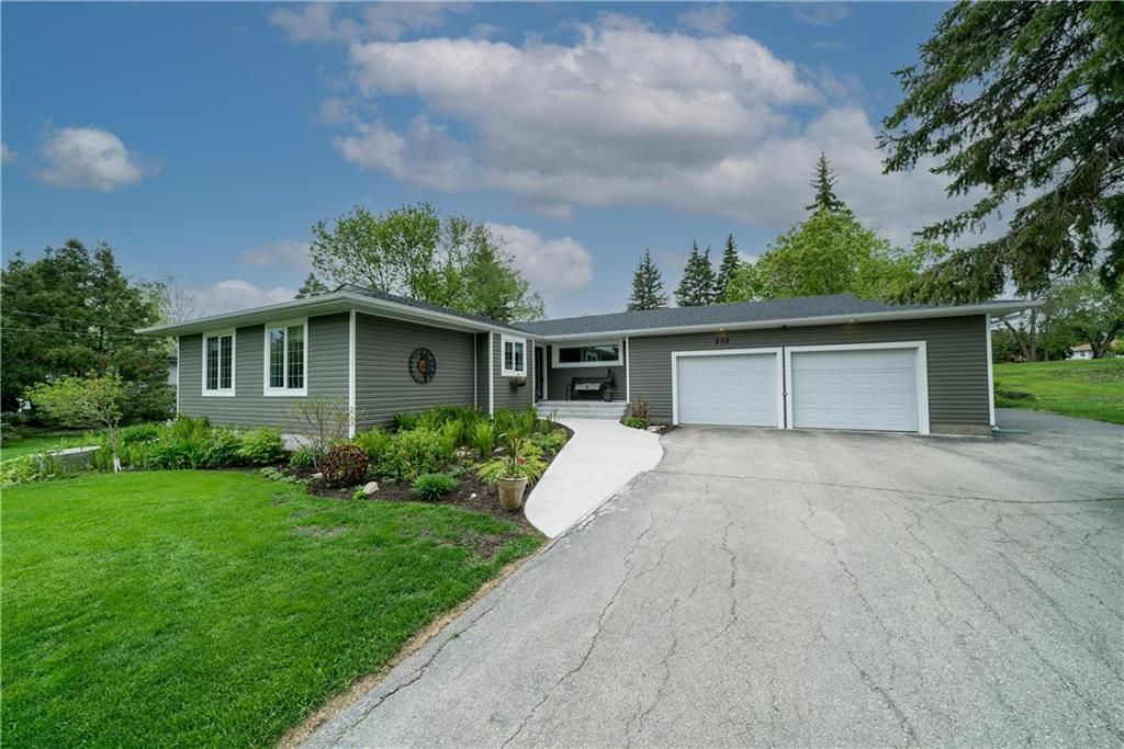 Welcome to 292 Minnehaha Ave in West St Paul! Gorgeous landscaped property on 2/3 Acre w/in-ground pool!