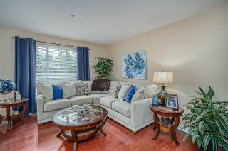"Photo 3: 202 13860 70 Avenue in Surrey: East Newton Condo for sale in ""Chelsea Gardens"" : MLS®# R2526715"