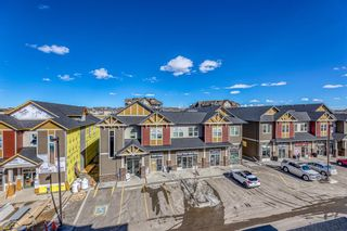 Photo 18: 9308 101 Sunset Drive: Cochrane Apartment for sale : MLS®# A1079009