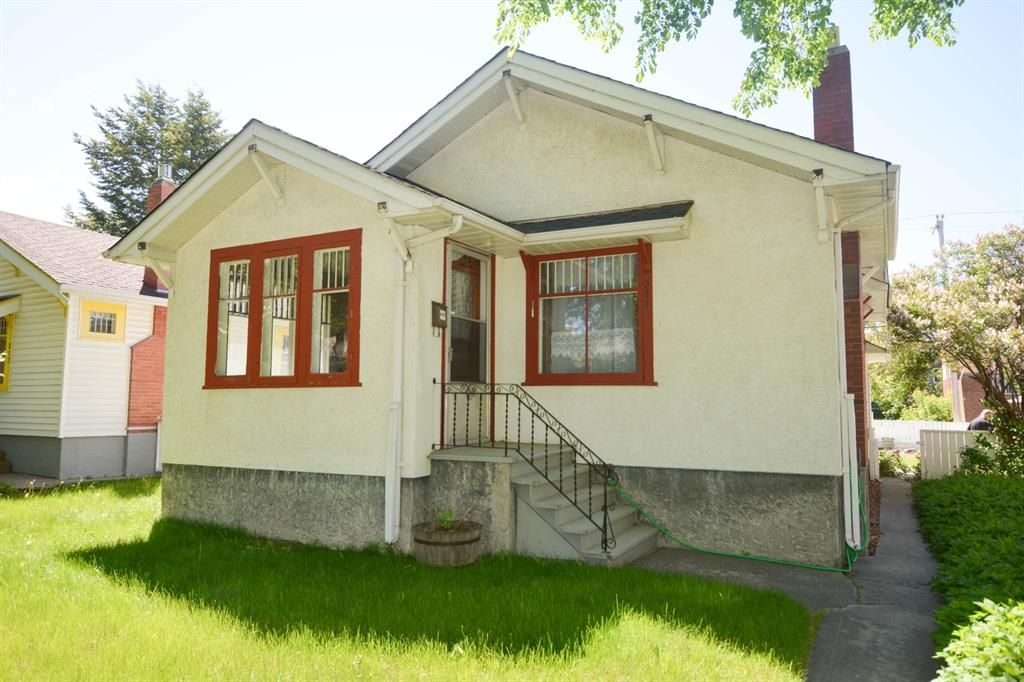 Main Photo: 211 7 Avenue NE in Calgary: Crescent Heights Detached for sale : MLS®# A1117902