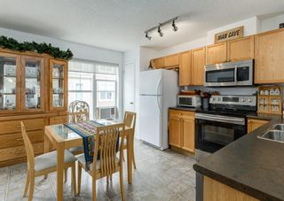 Photo 6: 311 Toscana Gardens NW in Calgary: Tuscany Row/Townhouse for sale : MLS®# A1118245