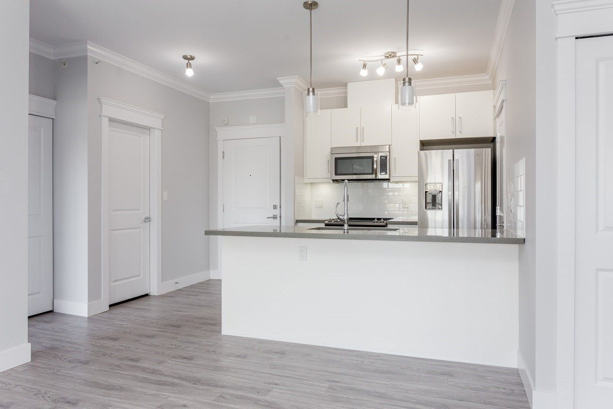 """Main Photo: 405 2229 ATKINS Avenue in Coquitlam: Central Pt Coquitlam Condo for sale in """"Downtown Pointe"""" (Port Coquitlam)  : MLS®# R2440972"""