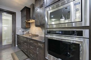 Photo 8: 419 Evansglen Drive NW in Calgary: Evanston Detached for sale : MLS®# A1095039