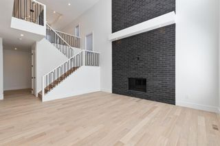 Photo 6: 7853 8a Avenue SW in Calgary: West Springs Detached for sale : MLS®# A1120136