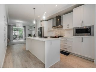 """Photo 5: 16 2550 156 Street in Surrey: King George Corridor Townhouse for sale in """"Paxton"""" (South Surrey White Rock)  : MLS®# R2385425"""