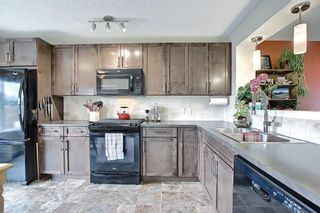 Photo 7: 95 Auburn Meadows Heath SE in Calgary: Auburn Bay Semi Detached for sale : MLS®# A1134082