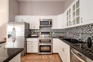Photo 6: 324 Prominence Heights SW in Calgary: Patterson Row/Townhouse for sale : MLS®# A1071235
