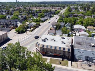 Photo 5: 701 14 Street NW in Calgary: Hillhurst Mixed Use for sale : MLS®# A1128858